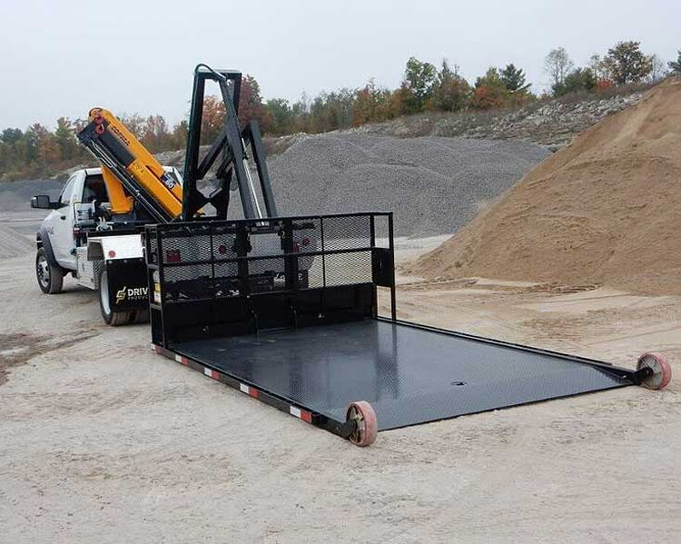 Dump body truck with empty ground level platform